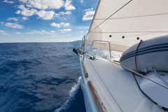 Anchor and furling drum on the yacht bow in sea. Anchor, forestay and furling drum on the yacht bow in sea Royalty Free Stock Photography
