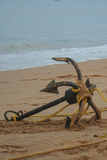 Anchor on Goan beach with yellow rope Royalty Free Stock Photo