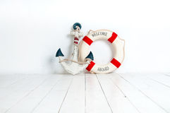 Anchor and life buoy on a white wooden floor Stock Images