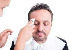 Anchor man make-up. Anchor men receiving make-up before tv news Stock Image