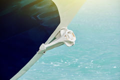 Anchor on modern yacht. Yacht detail - anchor on modern yach boat on a sunny day Royalty Free Stock Images