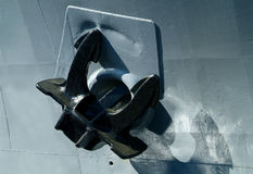Anchor of navy ship. Anchor and hull of navy ship Stock Images