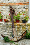 Anchor near the wall with flowers Stock Photo