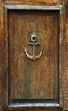 Anchor on old wooden door Stock Photo