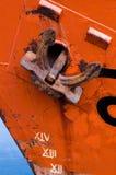 Anchor on orange boat stock image