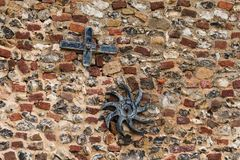 Wall Anchor Plates on Old Building. Anchor plates attached to old brick and flint walled building in Norfolk stock images