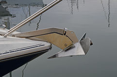 Anchor - Bow Of A Yacht With A Boat Anchor. A plough or delta type of anchor on the bow of a yacht Royalty Free Stock Photo