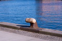 An anchor point for ships to tie to when moored stock images