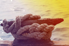 Anchor pole and rope Royalty Free Stock Photo