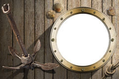 Anchor and Porthole on Wooden Wall Royalty Free Stock Photo