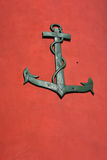 Anchor on red background Royalty Free Stock Photo