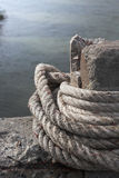 Anchor rope tie up the stone pillar Stock Image