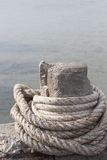 Anchor rope tie up the stone pillar Stock Photos