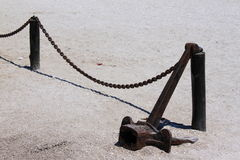 Anchor on the sand Stock Images