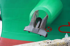 Anchor on the ship close-up. One heavy iron anchor on shipboard close-up Stock Image