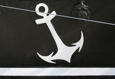 Anchor symbol. A white anchor symbol on the side of a boat royalty free stock photos