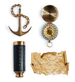 Anchor, telescope, compass and map or parchment royalty free stock photography