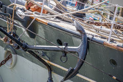 Anchor tied to side of sailboat Stock Photo