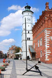 Anchor and town hall. Anchor on the background of the historic town hall in Sandomierz (Poland Stock Images