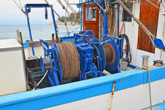 Anchor winch with hawser. Anchor winch mechanism with hawser on ship deck Royalty Free Stock Image