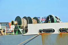 Anchor winch with hawser. Anchor winch mechanism with hawser on ship deck Stock Photo