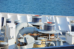 Anchor windlass with chain. Anchor windlass mechanism with chain on ship deck Stock Photo