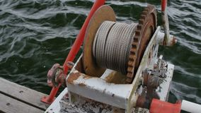 Anchor windlass mechanism with chain on ship deck.  stock video