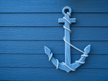 Anchor wooden blue background Royalty Free Stock Photography