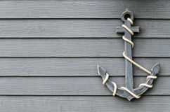 Anchor on the wooden wall Stock Photo