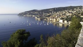 Anchorage Villefranche. Anchoring Bay of Villefranche sur Mer with view of the old town on a calm autumn day Royalty Free Stock Images