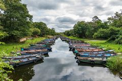 Anchored barges on Ross Island in the southwest of Ireland. stock photo