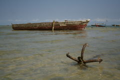Anchored Boat. Fishing boat anchored off the shore on the island of Zanzibar Stock Photography
