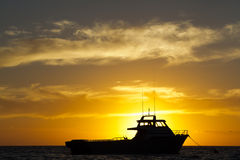 Anchored boat. Of West Australia coast with a beautiful sunset Stock Photo