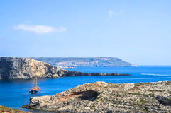 An anchored boat at Comino Island, Malta. Situated between Malta and Gozo, the small island of Comino is a paradise for snorkelers, divers, windsurfers and Stock Photo