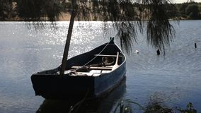 Anchored boat on the lake. Anchored boat on the shore of the lake in backlighting stock video