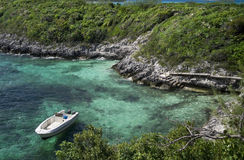 Anchored boat next to tropical island Stock Photo