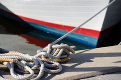 Anchored Boat and Ropes Royalty Free Stock Image