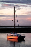 Anchored boat at sunset Royalty Free Stock Photos
