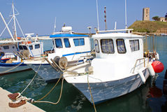 Anchored boats. Scenic view of boats moored in Halkidiki harbor, Greece Stock Photos