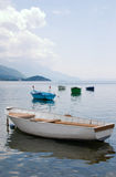 Anchored boats floating on water Stock Photography