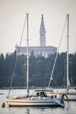 Anchored boats in front of Saint Euphemia bell tower Royalty Free Stock Photography