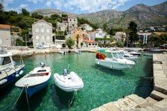 Anchored boats in Mlini. MLINI, CROATIA - JULY 22, 2017 : Boats anchored at pier at Dubrovnik riviera in Mlini, Croatia Royalty Free Stock Images