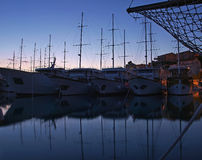 Anchored boats at night Stock Photos