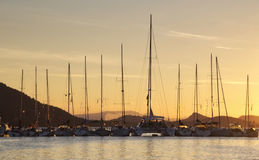 Anchored boats during sunset Royalty Free Stock Photography