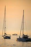 Anchored boats at sunset Royalty Free Stock Photo