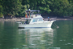 Anchored Cabin Cruiser Stock Images