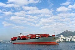 Anchored Container Ship. An fully-loaded container ship anchored in Victoria harbor, Hong Kong Stock Photo