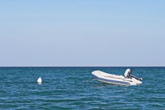 Anchored dinghy on sea Royalty Free Stock Image