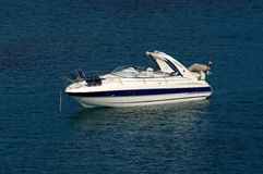 Anchored fast boat Stock Photography