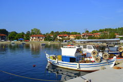 Anchored fisherman boats pier Greece Royalty Free Stock Photos